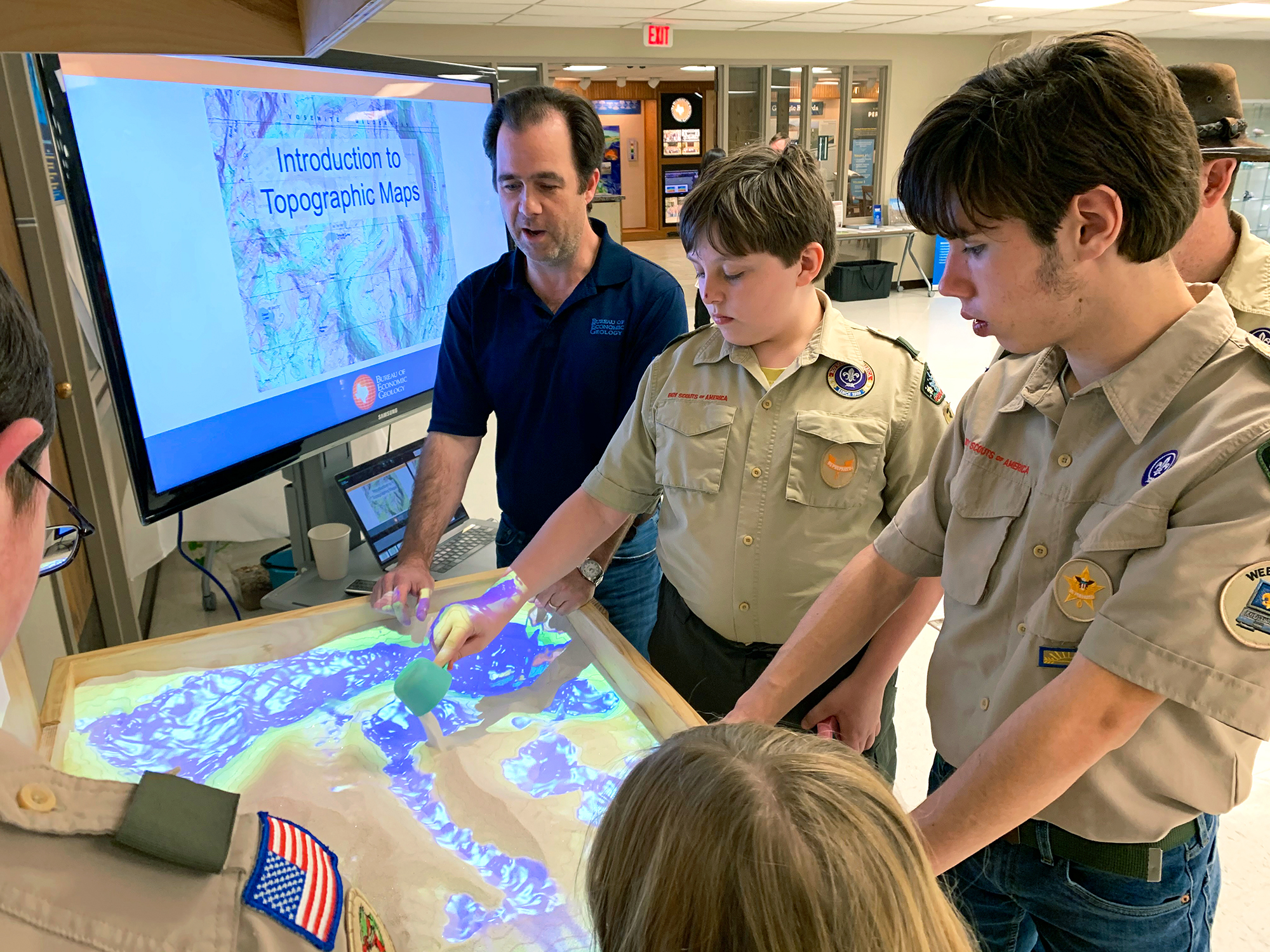 Dallas Dunlap applies a 3D perspective to topographic maps and geological processes using the Bureau's new Augmented Reality Sandbox.