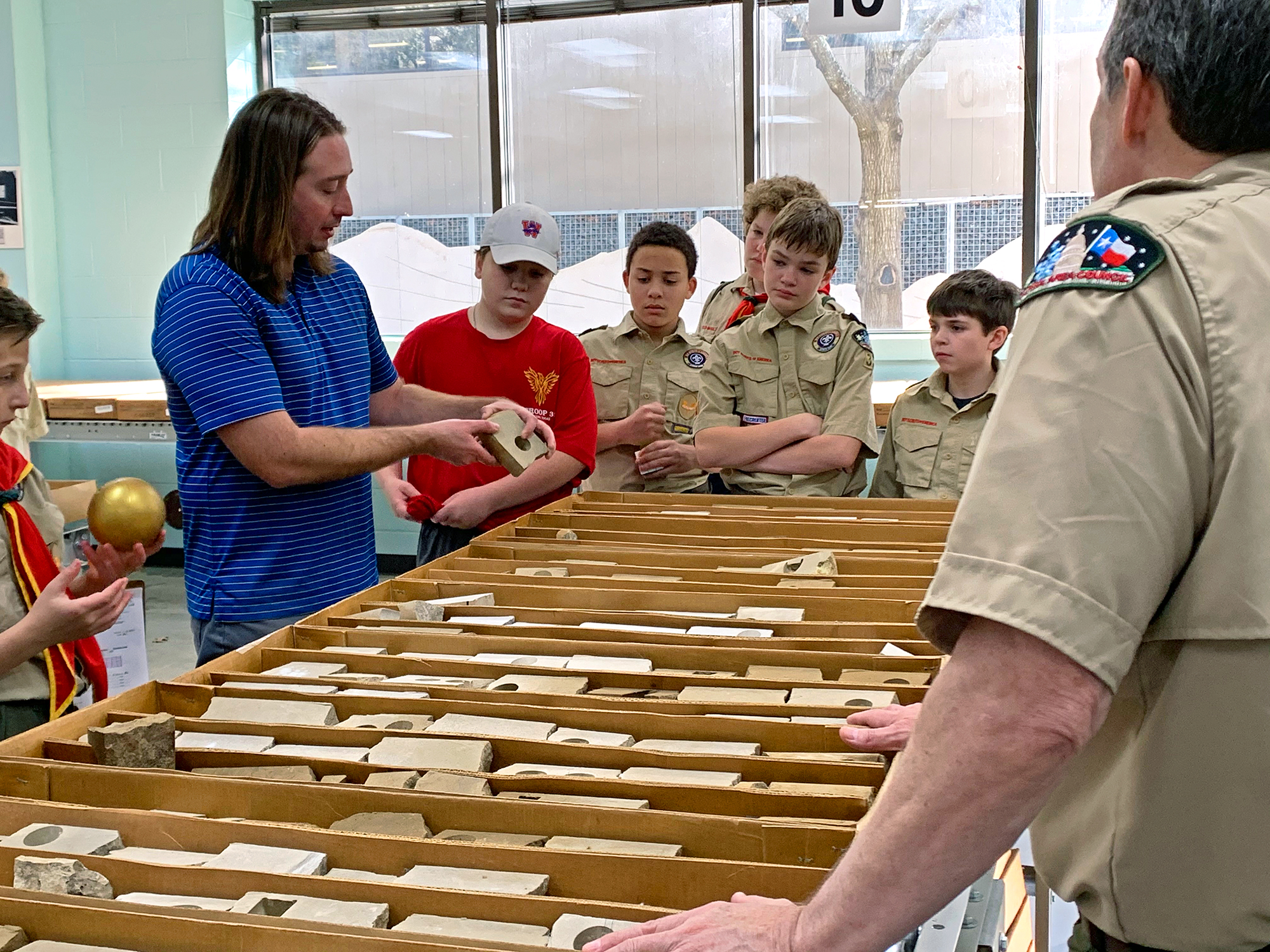 Nathan Ivicic shows the troop core samples in the Bureau's Core Research Center.