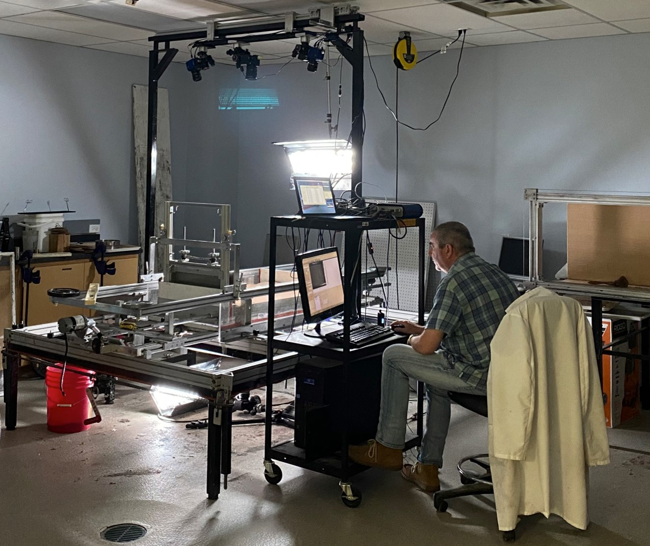 Tim Dooley completing work in the salt tectonics modeling laboratory while maintaining social distancing.