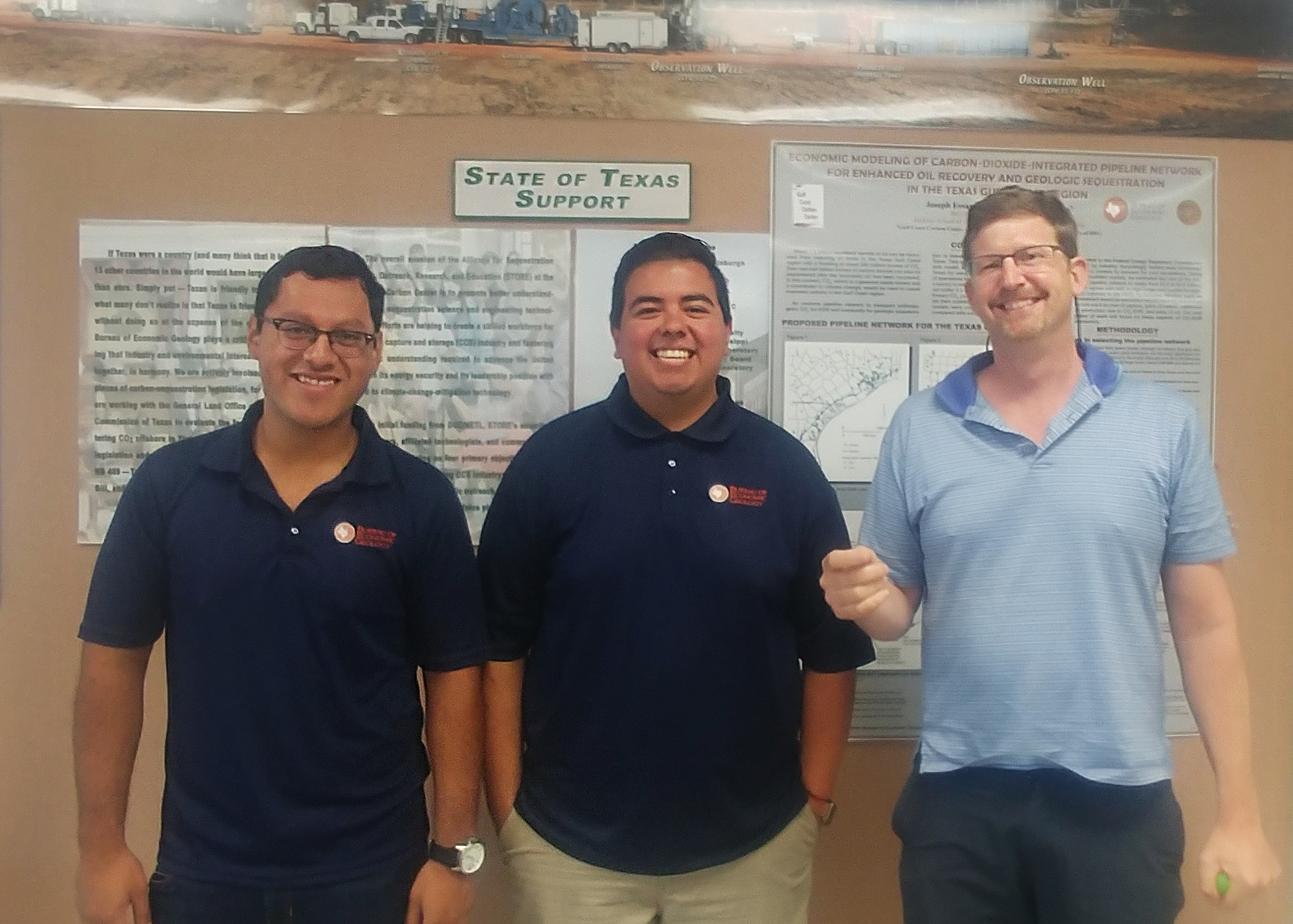 Photo of graduate research assistants Omar and Izaak with their adviser, Tip Meckel.
