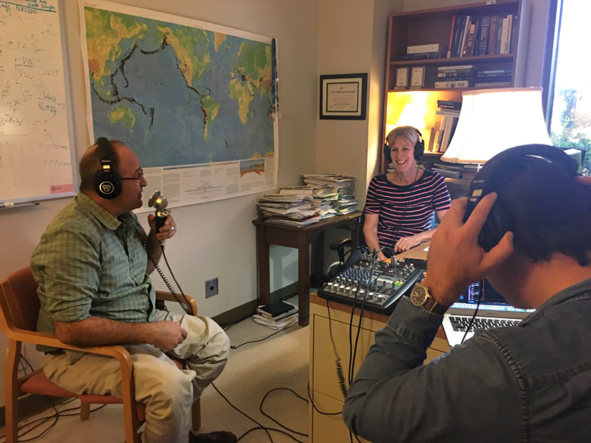 Photo of two podcast hosts interviewing Katherine in her office