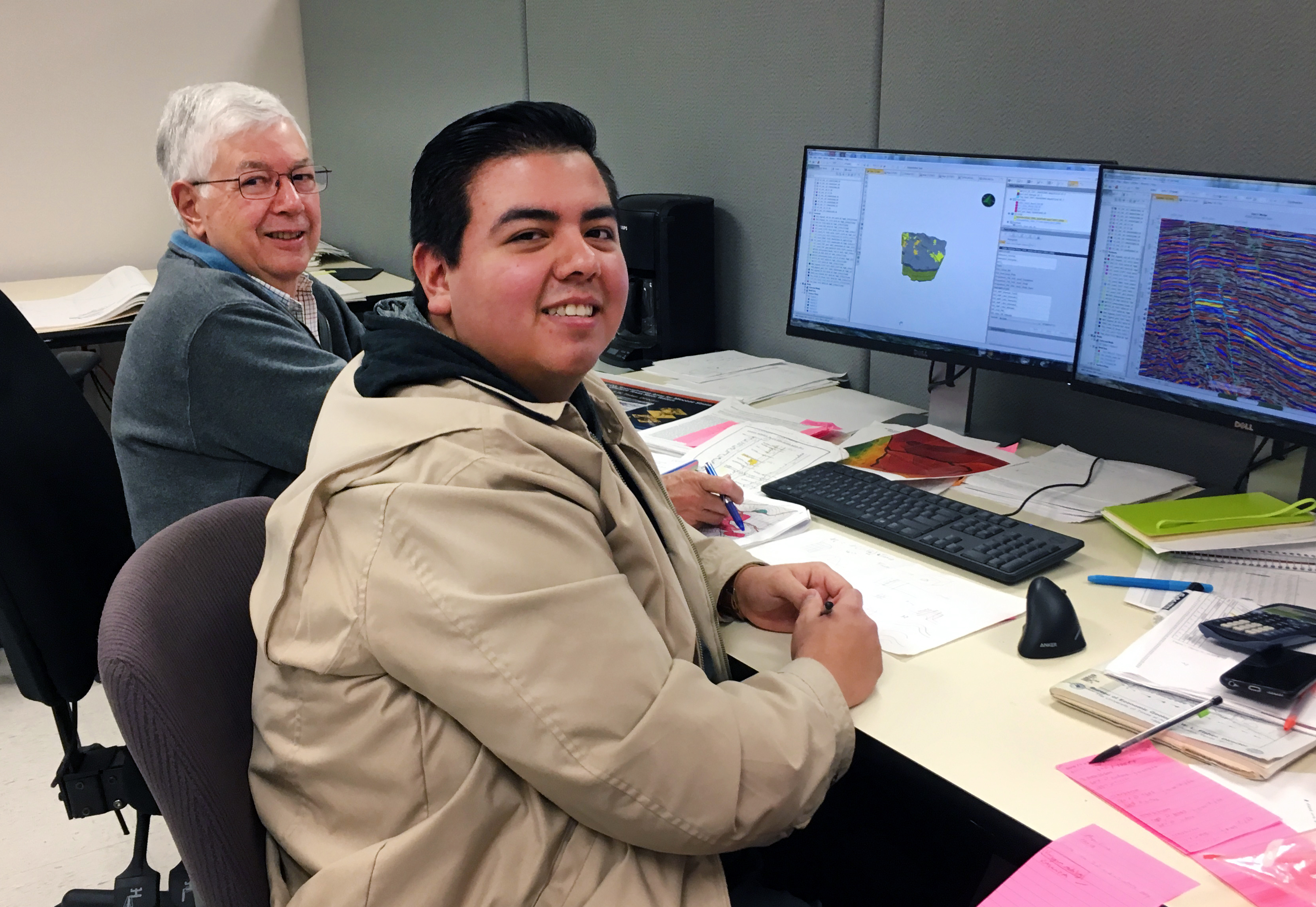 Rob Finley helps Izaak Ruiz troubleshoot subsurface modeling at the computer.