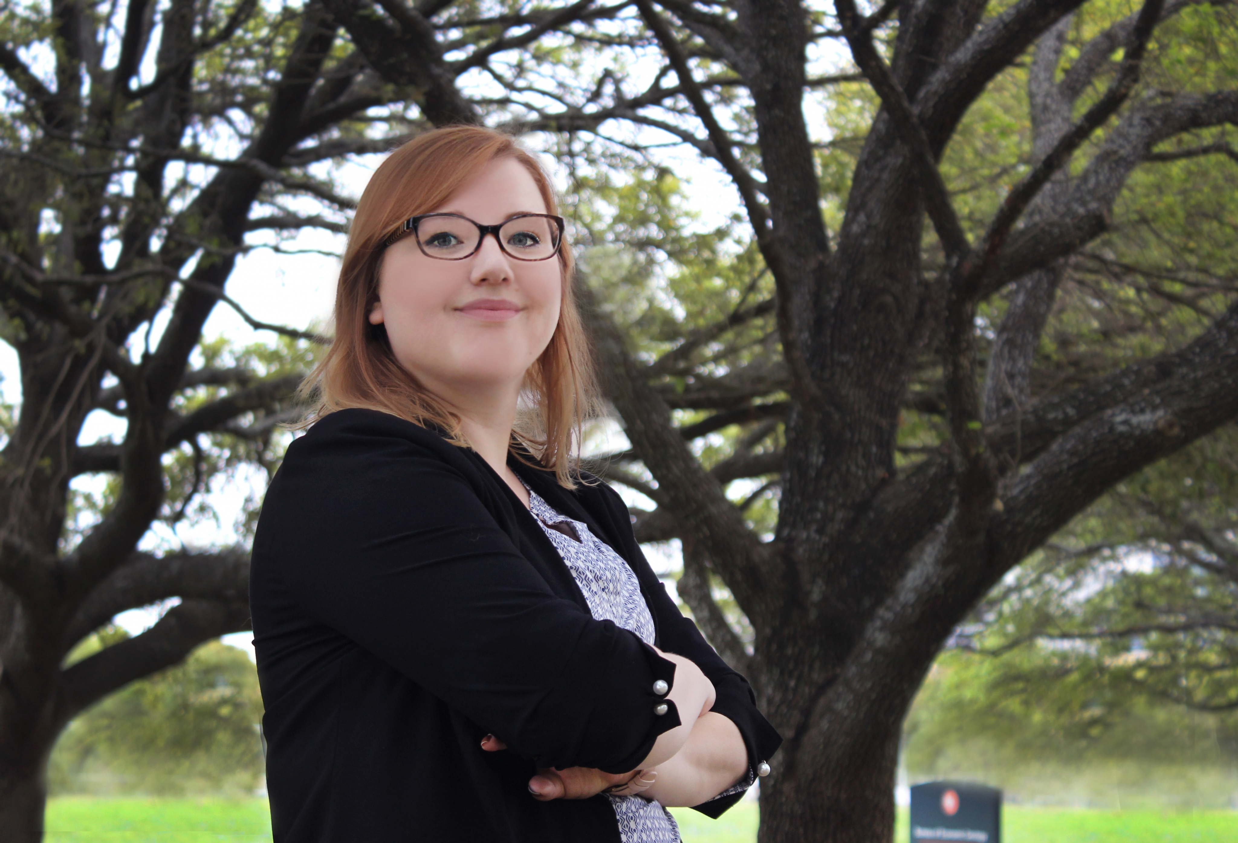 Sarah Prentice stands in front of the Bureau of Economic Geology building at the J. J. Pickle Research Campus.