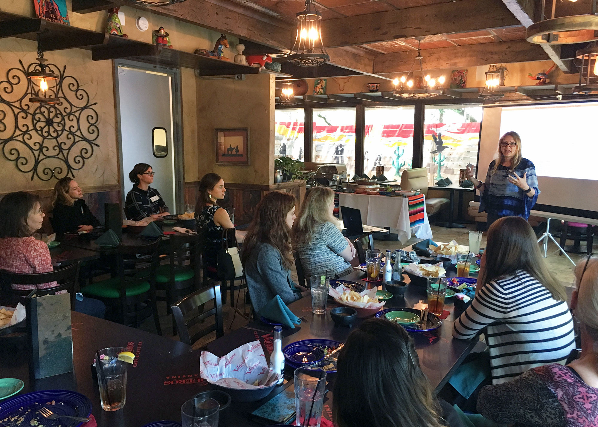 Photo of Vanessa speaking in front of an audience during the annual lunch meeting of Austin WOG