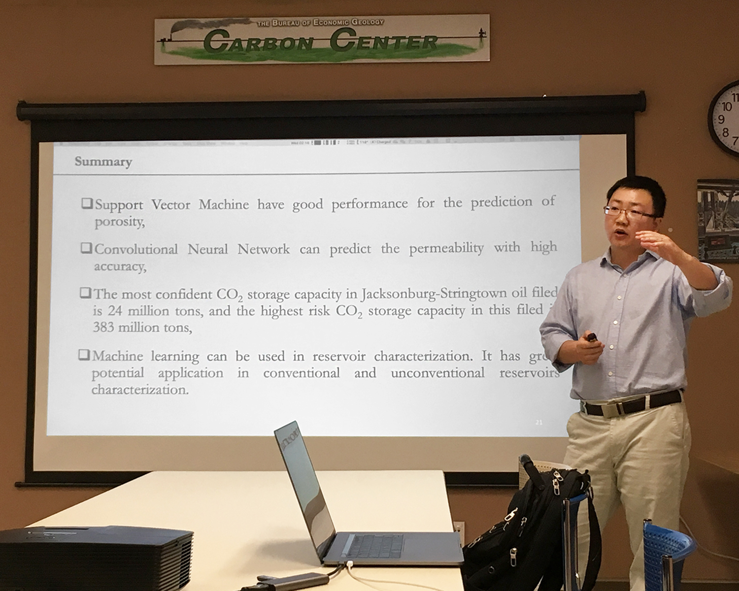 Zhi Zhong shows the summary slide of his presentation which says that machine learning methods of porosity and permeability have high accuracy and that machine learning can be used in unconventional and conventional reservoir characterization with success.