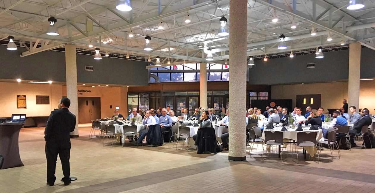 Photo of the attendees in the Commons Center atrium at the JJ PIckle Research Campus at dinner tables during the talk