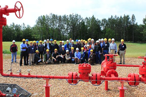 Participants at the IEAGHG Monitoring Network Meeting 2010 pose during a field trip led by the GCCC to the Cranfield Field.
